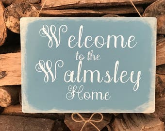 Personalised wooden welcome to the *surname* home sign plaque