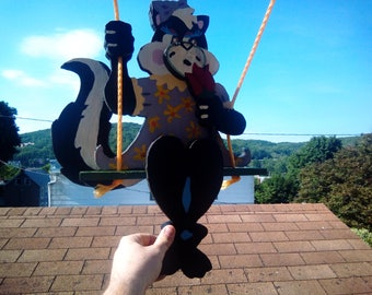 Skunk on a swing this is a swinger