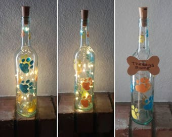Wine bottle lights, Recycled wine bottle lamp with painted paws, Dog lover gift, Decor with dog prints, Free removable personalized bone