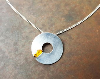 Donut pendant with amber