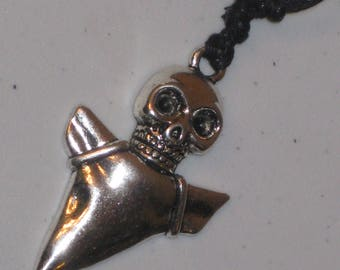 Skull and shark tooth pendant necklace.