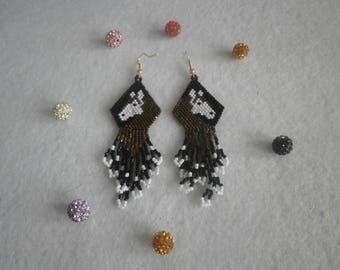 "Earrings ""horse"" bronze, white and black."