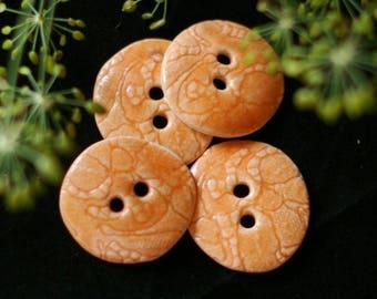 2 orange buttons carved porcelain
