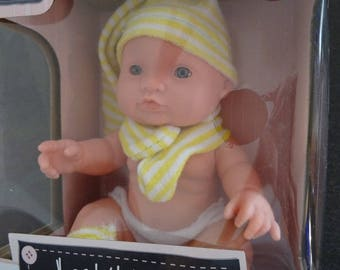 This little doll is dressed in clothes-funny