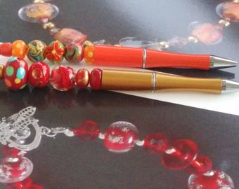 Pen gilt - decorated with red and gold glass beads
