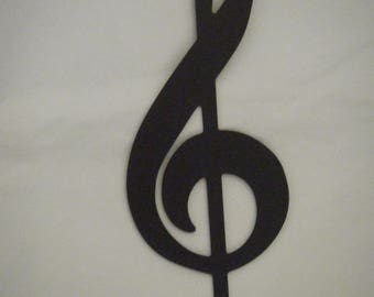 Treble clef silhouette in woodcut