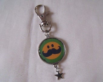 key silver green yellow black mustache