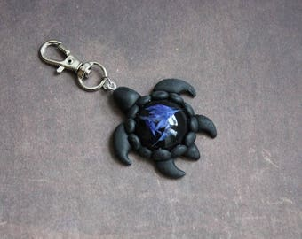 Jewelry bag turtle 4, 5 x 4, 5cm black resin with inclusion of blueberries
