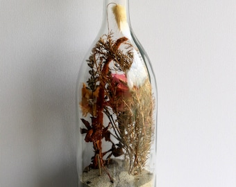 Glass bottle filled with sand and plant in Corsica 31 x 8.5 cm (1 PCs).