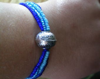 Blue seed beads and silver charm bracelet