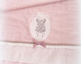 Embroidered pink towel with a Suspender corset