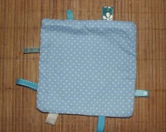 Blue polka dots for your baby cuddly.