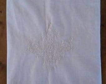 White cotton with embroidered Monogram TB