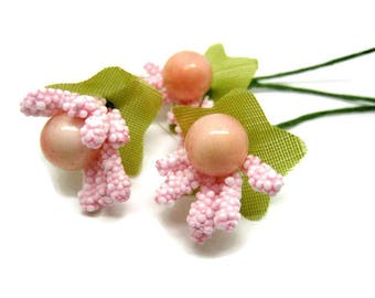 3 bunches with pale pink berries on stems approximately 2.5 cm