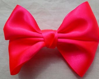 Large double ribbon bows.