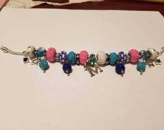 We make glass bead charm bracelets