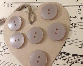 6 large buttons flesh color