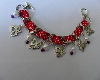Red Ribbon and charm bracelet