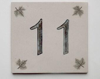 Door plate beige stoneware, number 11, ivy leaves