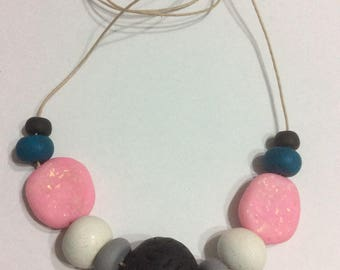 Black, pink, teal, white and  grey polymer clay necklace