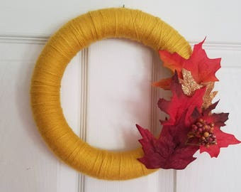 Beautiful gold autumn wreath with fall leaves