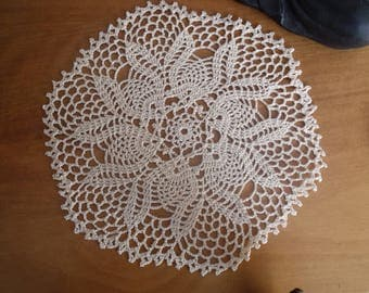 Ecru colored crochet doily