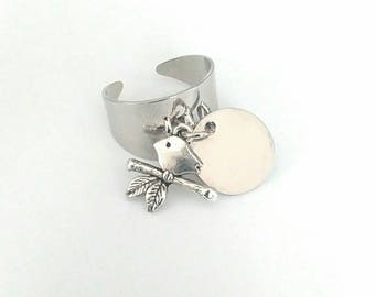 Adjustable silver ring. 2 pendants. A 15mm round and a bird.