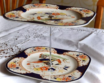 Delicate two tier cake stand.  1940s era.  Perfect for afternoon tea. Chrome plate holder