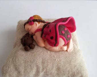 Sleeper baby girl and her teddy bear, 7 cm