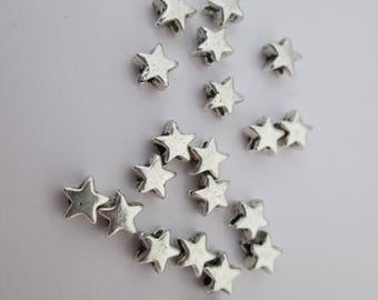 20 perles étoile 6 mm en métal argenté