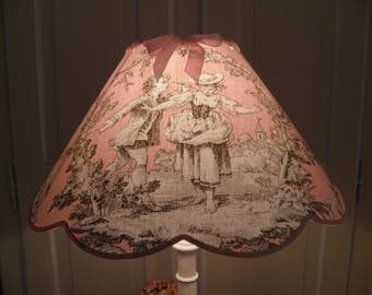 Pink lamp shade scalloped toile de jouy background