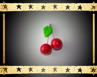Two red cherries Cherry with a green leaf