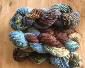 460 g hand dyed and handspun wool.