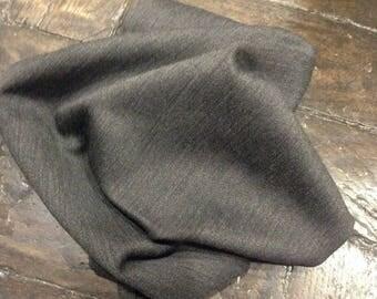 A plain charcoal grey wool coupon