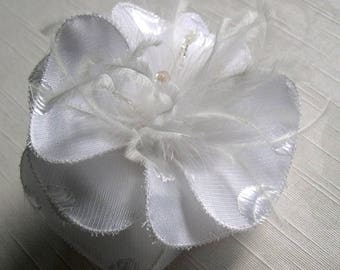 White fabric flower hair clip, feathers and beads