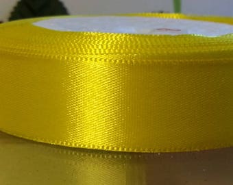 1 meter of 20mm wide yellow satin ribbon
