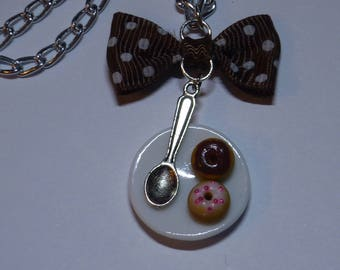Collar plate of donuts with clay spoon