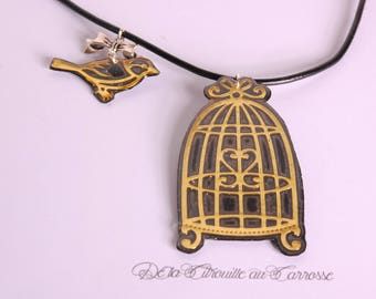 Black gold bird cage and bird necklace