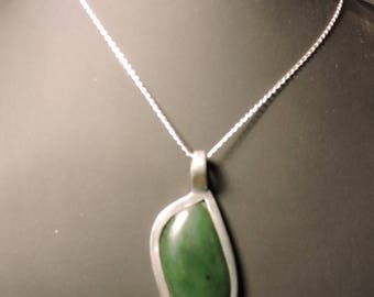 Necklace with jade, brass setting