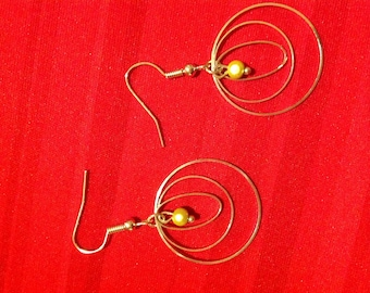 Earrings circles and miracle bead.