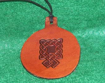 Leather with a tracery design pendant