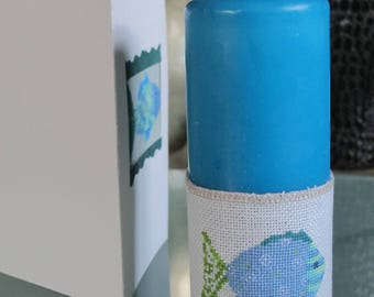 Shield white candle with candle turquoise fish