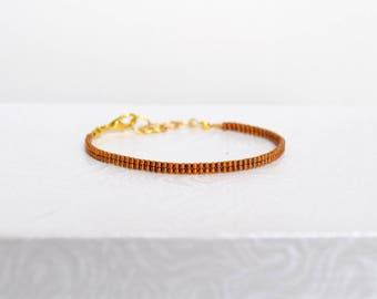 Bracelet weaved 24KT Gold plated beads