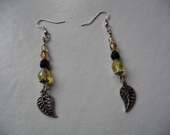 Earrings faceted beads and leaves.