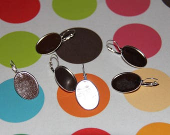 The pair of earrings featuring 18 X 25 oval top