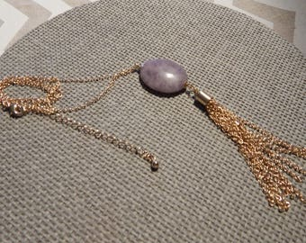 Gold long chain necklace, pendant stone and silver chain tassel effect
