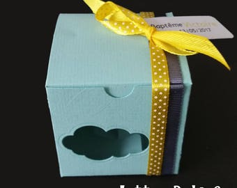 Light blue, grey and yellow cube shaped box dragees