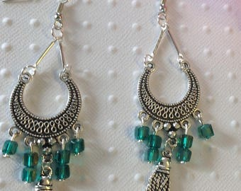 Earrings accented with blue green beads