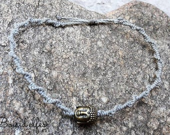 Macrame bracelet with the color you would like. Grey Buddha