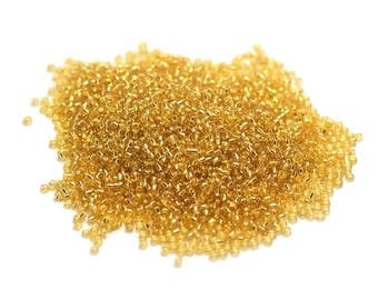 20g beads 2mm glass seed beads, translucent gold